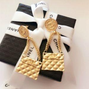 Gold coco dangle purse earrings cc
